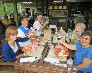 A group of Visionaries members raising their glasses at Creekside winery on our 2016 Bus Trip.